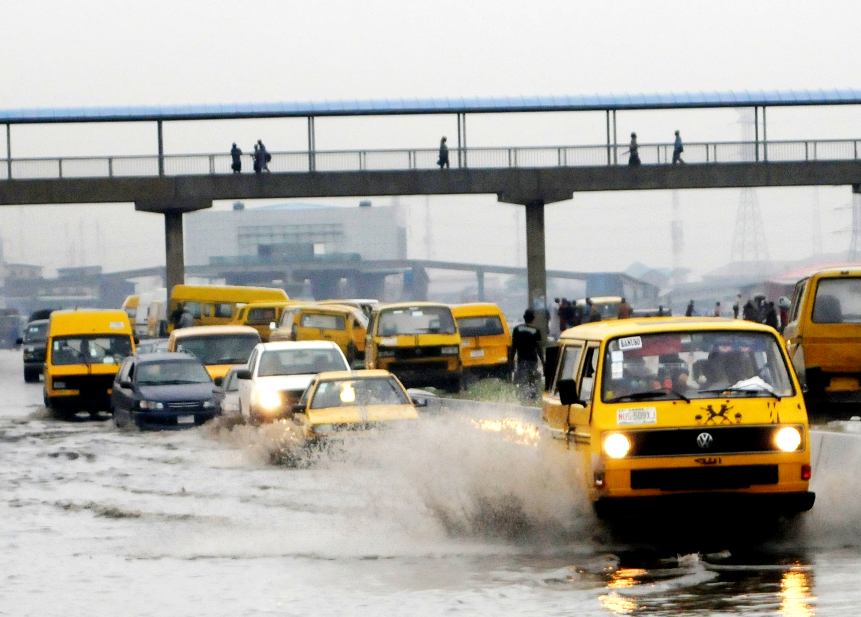 Danfo wading through water on a rainy Lagos day