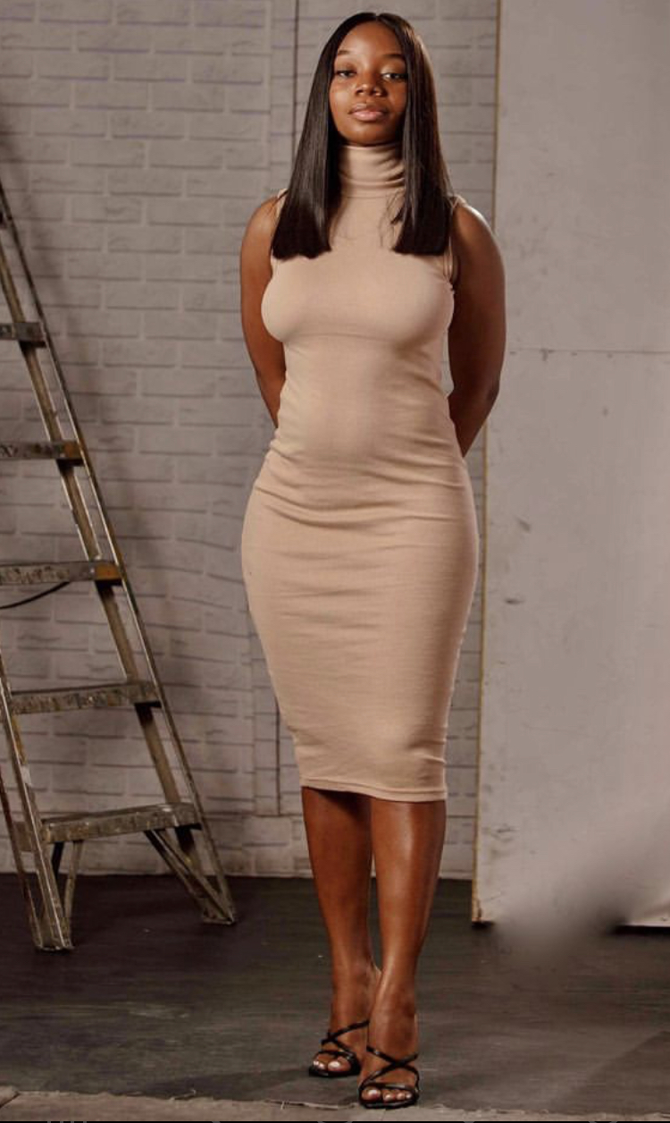 Bolu in nude colored dress from Bfits.